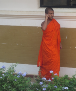 Monk with mobile phone