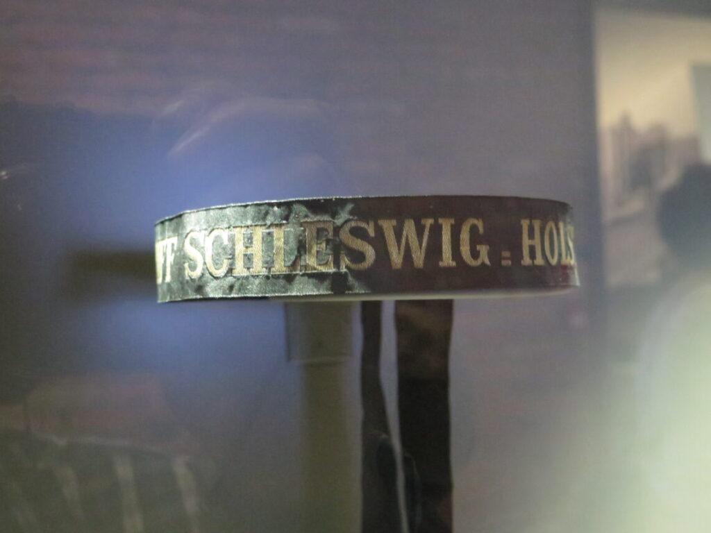 Bånd fra kasket fra Schleswig-Holstein krigsskibet